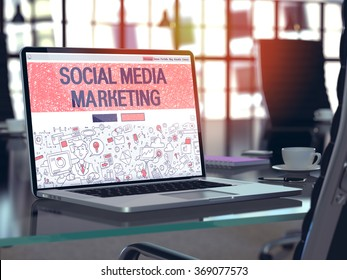 Modern Workplace with Laptop showing Landing Page in Doodle Design Style with text Social Media Marketing. Toned Image with Selective Focus. 3d render.