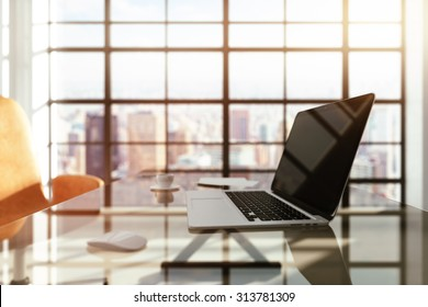 modern workplace with a laptop at sunrise - Shutterstock ID 313781309