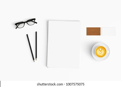 Modern workspace with coffee cup, paper and pencils copy space on white color background. Top view. Flat lay style.