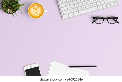 Modern workspace with coffee cup, smartphone, tablet, paper, keyboard and notebook copy space on purple color background. Top view. Flat lay style.