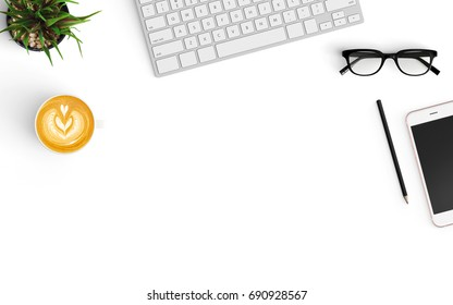 Modern workspace with coffee cup, smartphone, notebook, and keyboard copy space on white color background. Top view. Flat lay style.