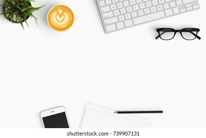 Modern workspace with coffee cup, smartphone, paper and keyboard copy space on white color background. Top view. Flat lay style.