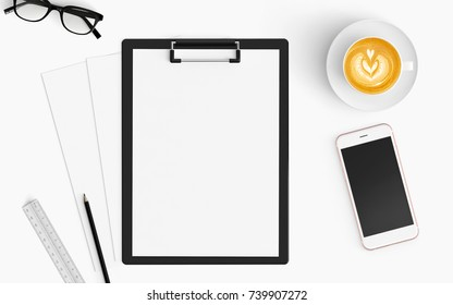 Modern workspace with coffee cup, smartphone, paper and clipboard copy space on white color background. Top view. Flat lay style.