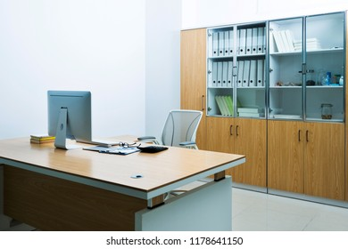 Modern workspace with computer and chair.