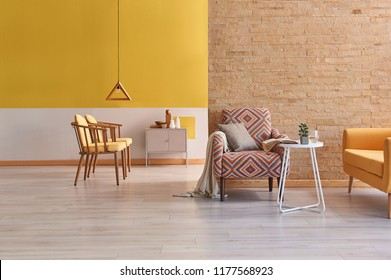 Modern yellow detail living room concept two side room with yellow wall and brick wall decoration.