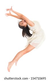 Modern young Asian teen contemporary dancer poses in front of the studio background, full length isolated white.