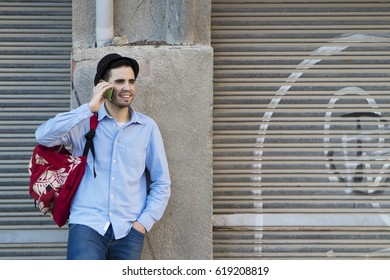 modern young man with the mobile phone in the city outdoors