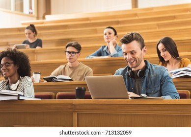 Modern young people studying in lecture hall