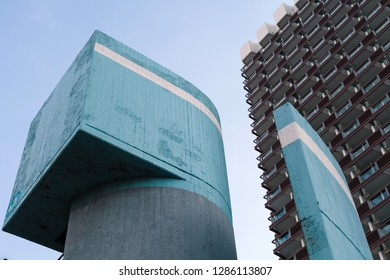 Modernist concrete architcture in teal.