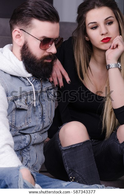 modernly dressed man and a girl posing next steps