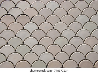 Modern-style ceramic tiles at the wall of the building in Lisboa (Portugal)