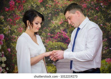 A modest betrothal of the newlyweds at the registry office in a small town. Warm moments for the bride and groom and the beginning of family life