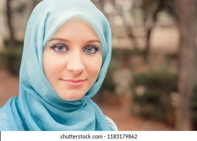 Modest girl in a blue kerchief. Muslim girl.