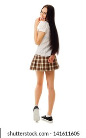 Modest girl in plaid skirt isolated