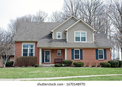 Modest Red Brick House with Black Shutters