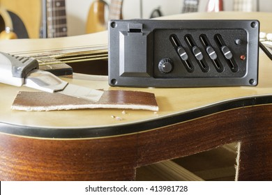 modified acoustic guitar,pre-amp put in body of acoustic guitar,background