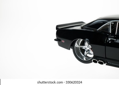 Modified black Chevrolet Camaro models tire rim detail. Isolated on white.