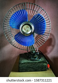 The modified wall fan becomes a stand fan.  It is modified for current use.