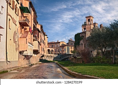 Modigliana, Forli-Cesena, Emilia-Romagna, Italy: landscape of the old town with the canal and the ancient houses