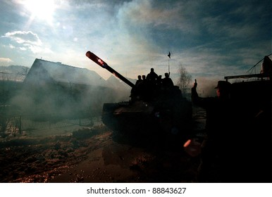 MODRICA, BOSNIA, 08 JANUARY 1993 --- Bosnian Serb tanks pass through this northern Bosnian city on their way deep into contested territory.