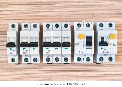 Modular electric circuit breakers, RCD and differential automatic. Residual current device and differential switch with test buttons. Modern and reliable product line. Compact version.