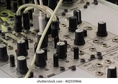 modular synthesizer, analogue synth closeup - music equipment
