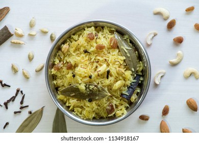 Modur Pulaois a delicious and aromaticKashmiri sweetened rice. Aromatic, mild and sweet pulao loaded with dry fruits and fresh fruits.