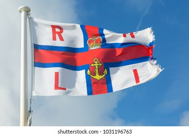MOELFRE, ANGLESEY -  FEBRUARY 17th  2018: RNLI flag flying outside Moelfre lifeboat station, home of 'RNLB KIWI'