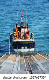 Moelfre lifeboat on Anglesey in North Wales, UK being recovered to lifeboat station and washed down after rescue. Taken 8 April 2018