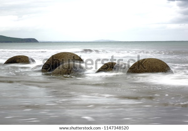 Moeraki boulders in long exposure to the waves of time