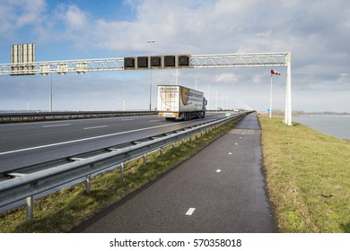 MOERDIJK, THE NETHERLANDS – JANUARY 29: Moerdijkbrug on Hollands Diep with a truck riding on it on January 29, 2017
