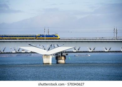 MOERDIJK, THE NETHERLANDS – JANUARY 29: Train rides on the railway bridge over the Hollands Diep in Holland on January 29, 2017