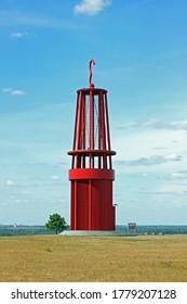 """Moers, Germany - 05 02 2020: Landmark """"Das Geleucht"""" on Halde Rheinpreussen in Moers Germany with blue sky in summer"""
