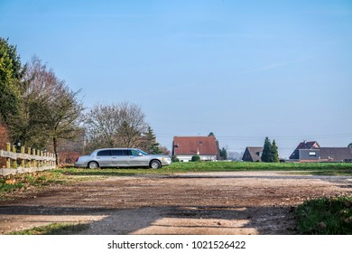 MOERS / GERMANY - FEBRUARY 09 2018 : Signed out extra long car standing in the field without numberplate