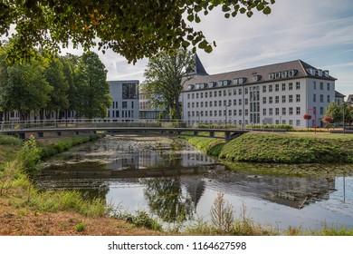 Moers - View to Rearside of Townhall with iron pedestrian bridge, North Rhine Westphalia, Germany, Moers, 26.08.2018