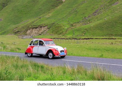 MOFFAT, SCOTLAND - JUNE 29, 2019:  Citroen 2cv car in a classic car rally en route towards the town of Moffat, Dumfries and Galloway