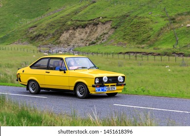MOFFAT, SCOTLAND - JUNE 29, 2019: 1982  Ford Escort MK2 1600 Sport car in a classic car rally en route towards the town of Moffat, Dumfries and Galloway
