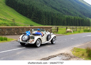 MOFFAT, SCOTLAND - JUNE 29, 2019: MG TD Sports car in a classic car rally en route towards the town of Moffat, Dumfries and Galloway
