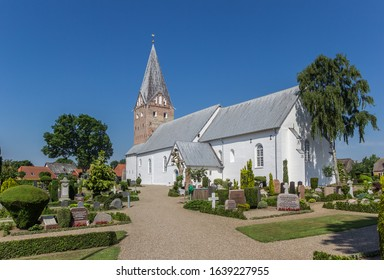MOGELTONDER, DENMARK - JUNE 26, 2019: Cemetery at the Mogeltonder Kirke church in Denmark