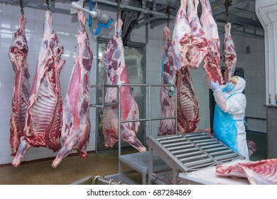 MOGILEV, BELARUS - JULY 24, 2017: cutting meat slaughterhouse workers in a meat factory
