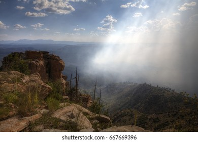 Mogollon Rim Bush Fire in Arizona A bush fire on Mogollon Rim in Arizona started due to the extreme dry heat. There's lots of smoke and shards of sunlight coming through it.