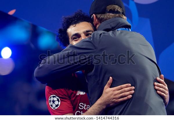 Mohamed Salah and Jurgen Klopp of Liverpool celebrate after winning the Champions League Final between Tottenham Hotspur and Liverpool at Estadio Wanda Metropolitano on June 1, 2019 in Madrid, Spain.