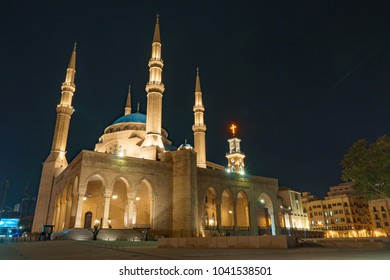 Mohammad al amin mosque and Saint George Maronite Greek Orthodox Cathedral at night in Beirut Lebanon