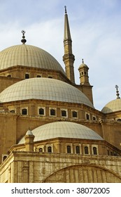 Mohammed Ali Mosque in Cairo, Egypt.  Photo centers on the domes of the mosque and one of the towers near the entrance.