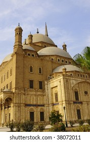 Mohammed Ali Mosque in Cairo, Egypt.  Photo centers on the domes of the mosque and the entrance.