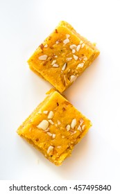 Mohanthal is a sweetened gram flour fudges made with Ghee, and flavored with saffron and almonds. It is a traditional Gujarati sweet quite popular during festivals, mainly Diwali