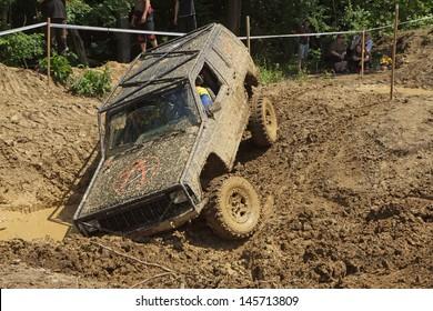 """MOHELNICE, CZECH REPUBLIC - JUNE 09. Off road car stuck in a muddy terrain in the """"BIG SHOCK CUP Trial 2013"""" on June 09, 2013  in the town of Mohelnice, Czech Republic."""