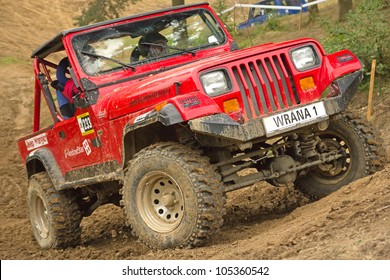 """MOHELNICE, CZECH REPUBLIC - JUNE 10. Unidentified racer at red off-road car in difficult terrain  in the """"SHOCK CUP Trial 2012"""" on June 10, 2012 in the town of Mohelnice, Czech Republic."""
