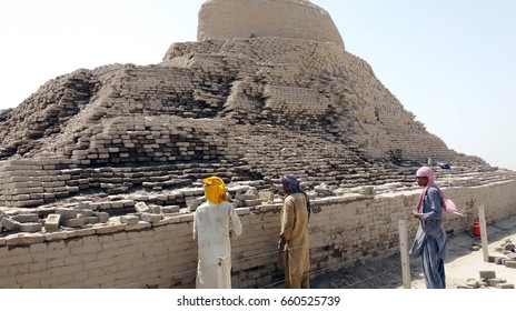 MOHENJO DARO, PAKISTAN - JUN 15: Labours construction work to save the World Heritage Site from monsoon rains under the supervision of Culture and Tourism Department on June 15, 2017 in Mohenjo Daro.