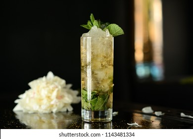 mohito (Mojito) drink coctail lemon ice fresh mint on table black background